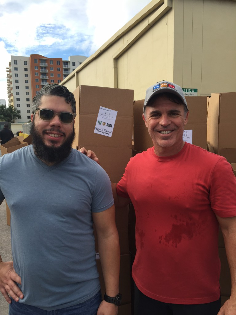 Rogers Clawson, GCN's Director of Corporate Strategies and Solutions, and Chris Palermo, GCN CEO and President, both volunteers at the Thanksgiving food drive